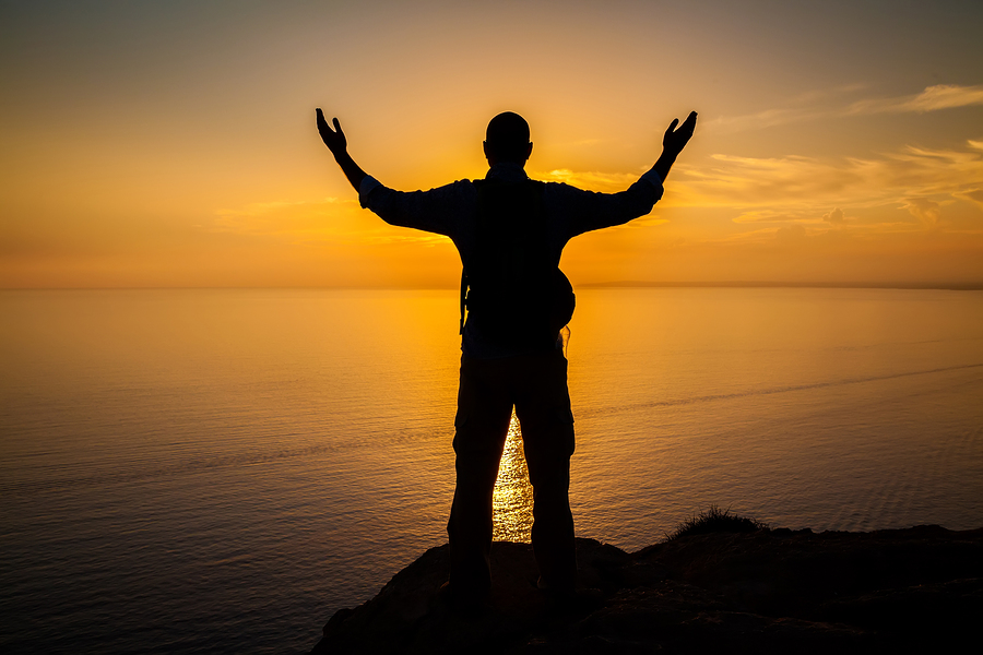 man standing on edge of a cliff