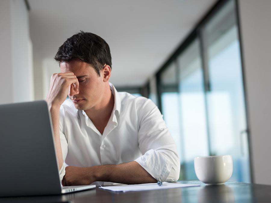 frustrated with problems young business man working on laptop co