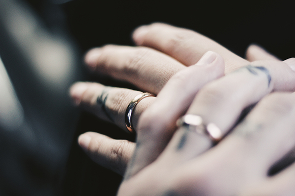 two married people's hands with wedding rings overcoming porn addiction in their marriage
