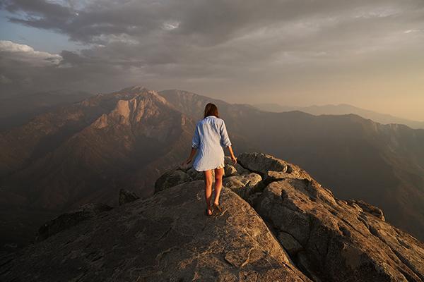 woman walking on a ridge